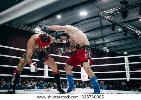 Volgograd, Russia - October 24, 2015: two fighters MMA strike each other blows during Championship of Russia on mixed martial arts - stock photo