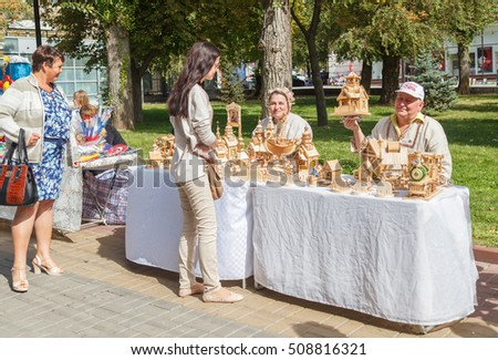 VOLGOGRAD, RUSSIA - September 11, 2016: Sale of wooden homemade products on the city street, the central embankment. Volgograd, Russia
