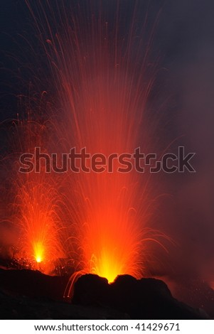 Volkano Stromboli with strombolian eruption - stock photo