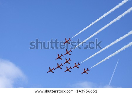 VOLKEL, NETHERLANDS - JUN 15: Patrouille Suisse demonstration during the Royal Netherlands Air Force Day on June 15, 2013 in Volkel, Netherlands. - stock photo