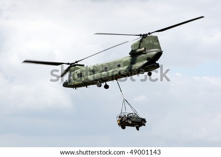 VOLKEL, NETHERLANDS - JUNE 16: Dutch Air Force CH-47 Chinook transports a vehicle during the Air Power Demo at Royal Netherlands Air Force Days June 16, 2007 in Volkel, Netherlands.