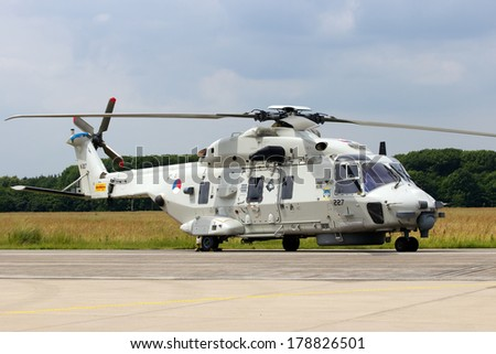 VOLKEL, NETHERLANDS - JUNE 14: New Dutch Navy NH 90 helicopter on display at the Royal Netherlands Air Force Days June 14, 2013 in Volkel, Netherlands.  - stock photo