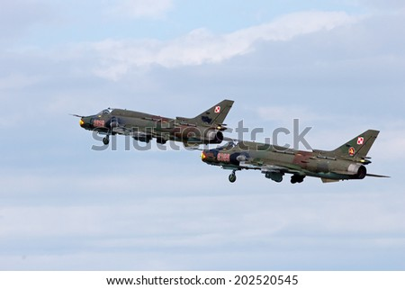 VOLKEL, THE NETHERLANDS - JUNE 15:Polish Sukhoi Su-22 bomber planes take off at the Dutch Air Force Open Day on June 15, 2013 in Volkel, The Netherlands - stock photo