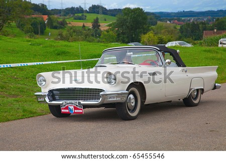 """VOLKETSWIL - AUGUST 15: The Ford Thunderbird car on the annual """"Oldtimer meeting"""" on August 15, 2010 in Volketswil, Switzerland - stock photo"""
