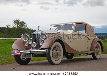 "VOLKETSWIL - AUGUST 15: The Rolls Royce car on the annual ""Oldtimer meeting"" in Volketswil, Switzerland on August 15, 2010 - stock photo"