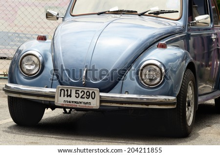Volkswagen retro vintage car / Vintage car / BANGKOK, THAILAND - JULY 11:Blue Volkswagen retro vintage car at car-park on July 11, 2014 in Bangkok Thailand.  - stock photo