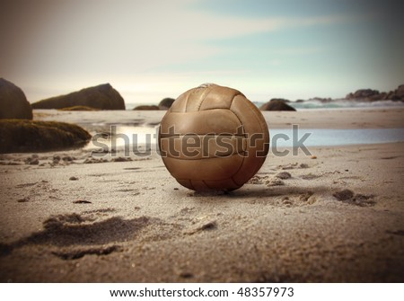 Volley ball lying on a beach - stock photo