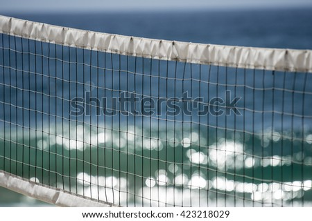 volley ball net detail on beach with ocean background   - stock photo