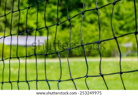 Volley ball net with green background of summer - stock photo