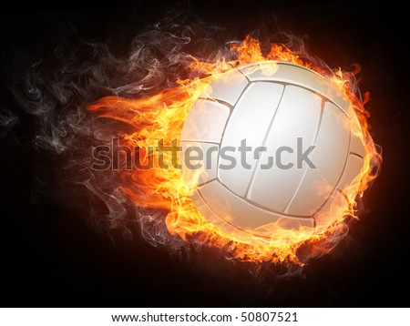 Volleyball ball enveloped in fire flames isolated on black background. - stock photo
