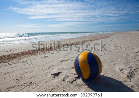 Volleyball ball on the sandy beach - stock photo
