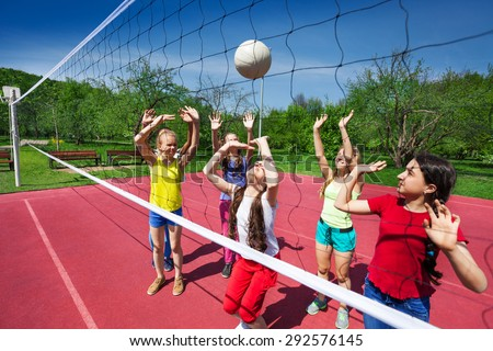 Volleyball game among children who actively play - stock photo