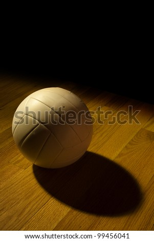 Volleyball left on the court after a game - stock photo