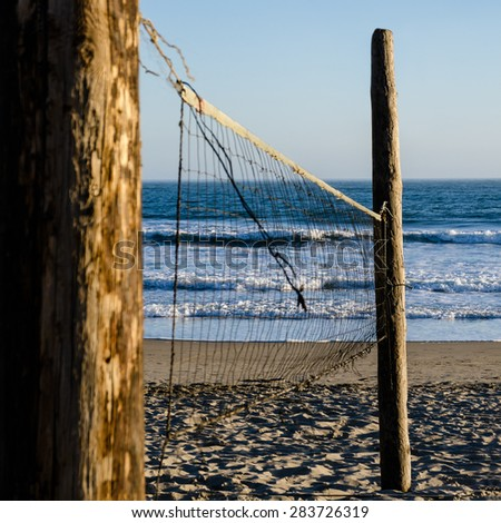 volleyball net against the beach - stock photo