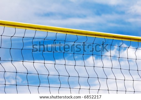 Volleyball net against the cloudy sky