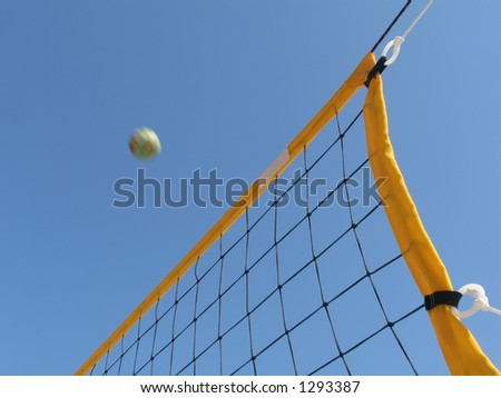 Volleyball net and ball in action. Space for text. - stock photo