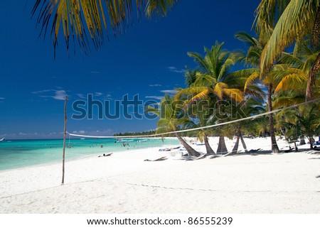 Volleyball net on caribbean beach, Saona - stock photo