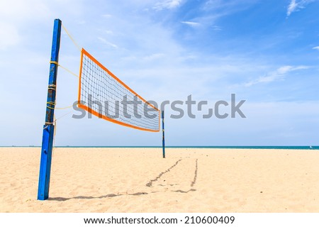 Volleyball net on the tropical beach with blue sky - stock photo