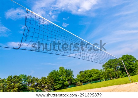 Volleyball net with blue sky on background - stock photo