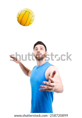 Volleyball player on blue uniform on white background - stock photo