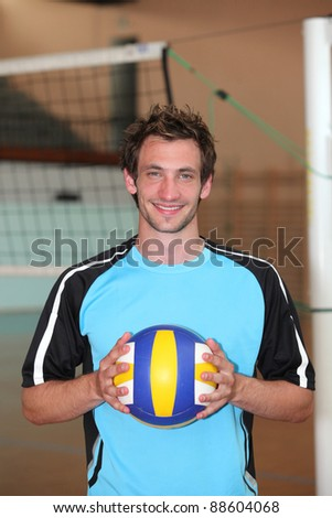 Volleyball player with ball - stock photo