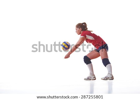 volleyball woman jump and kick ball isolated on white background - stock photo