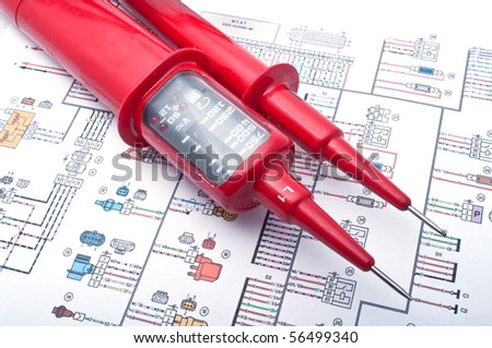 Voltage tester on electrical diagram - stock photo