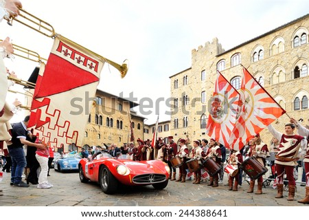 VOLTERRA (PI), ITALY - MAY 17: A red Maserati 300 S Fantuzzi, followed by a blue Porsche 356, takes part to the 1000 Miglia classic car race on May 17, 2014 in Volterra (PI). Both cars built in 1955. - stock photo