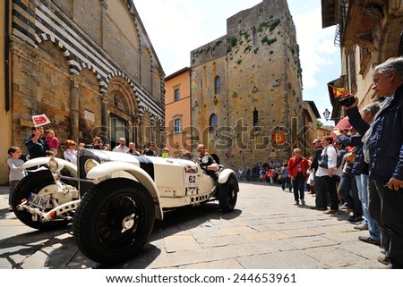 VOLTERRA (PI), ITALY - MAY 17: A white Mercedes SSKL 720 takes part to the 1000 Miglia classic car race on May 17, 2014 in Volterra (PI). The car was built in 1930. - stock photo