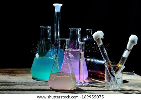 Volumetric laboratory glassware containing colored liquids