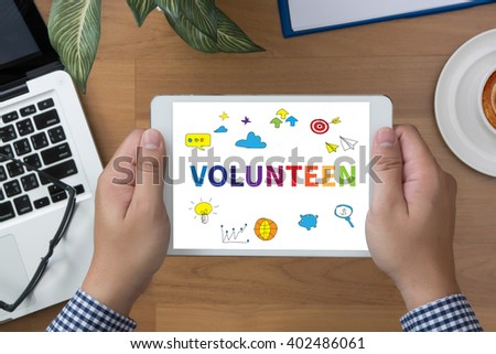 VOLUNTEEN man hand Tablet and coffee cup - stock photo