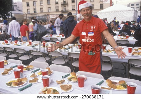 Volunteer at Christmas dinner for the homeless, Los Angeles, California - stock photo