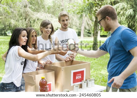 volunteer group receives food donation - stock photo
