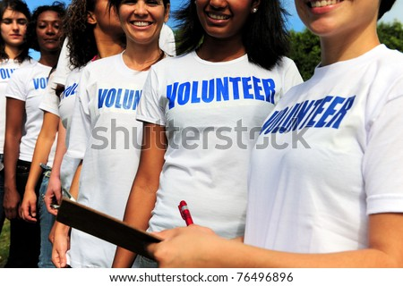 volunteer group register for charity event - stock photo