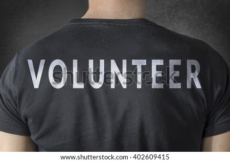 VOLUNTEER tittle on black t-shirt. Back view. - stock photo