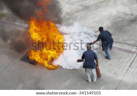 Volunteer try to extinguish the fire - stock photo