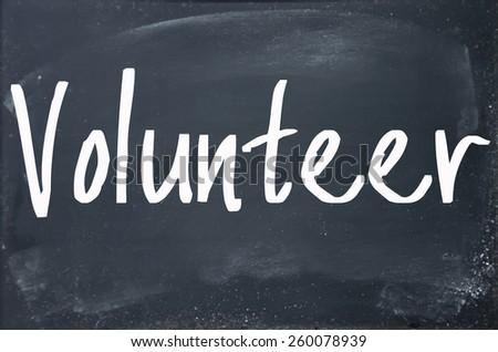 volunteer word write on blackboard - stock photo