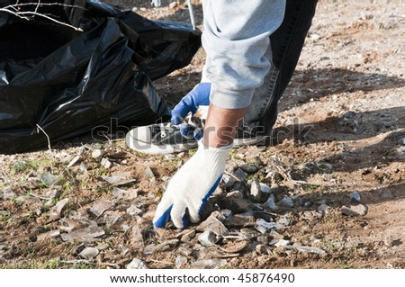 volunteers clean up trash in a park and on trails