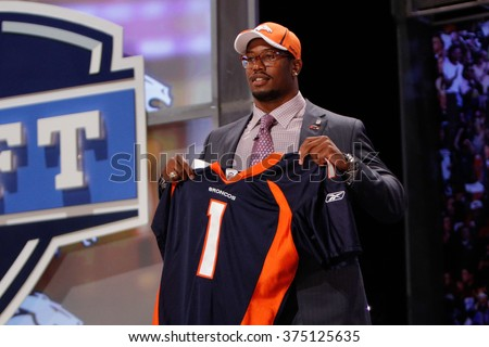 Von Miller (R) is introduced as the second pick to the Denver Broncos at the NFL Draft 2011 at Radio City Music Hall in New York, NY. - stock photo