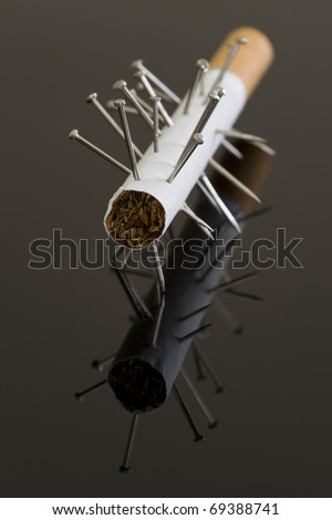 Voodoo cigarette, or is this acupuncture? - stock photo