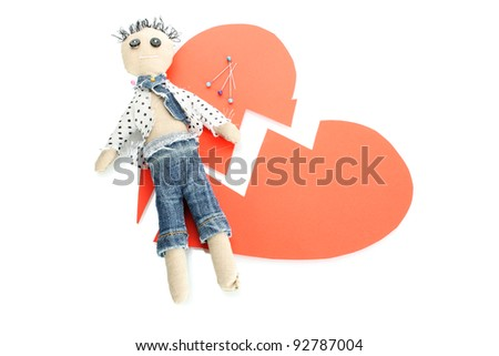 Voodoo doll boy on the broken heart isolated on white - stock photo
