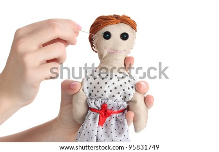 Voodoo doll girl in the hands of women isolated on white - stock photo