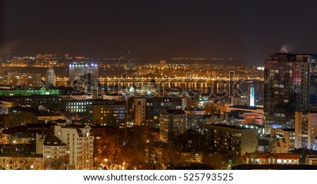 Voronezh city night scene, beautiful modern buildings, bright glowing lights.