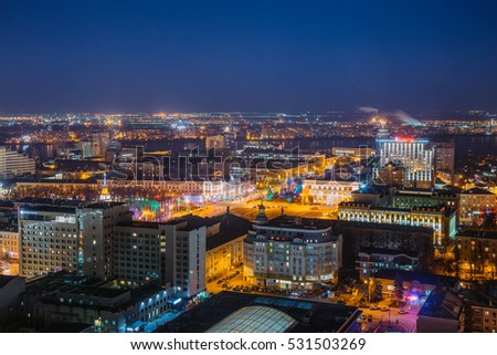 Voronezh, Russia - December 02, 2016: Night cityscape from rooftop to Lenin square. Houses, trade centers, night lights. Voronezh downtown