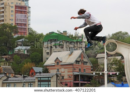 VORONEZH, RUSSIA - MAY 4, 2013 Boy jumping from a height.