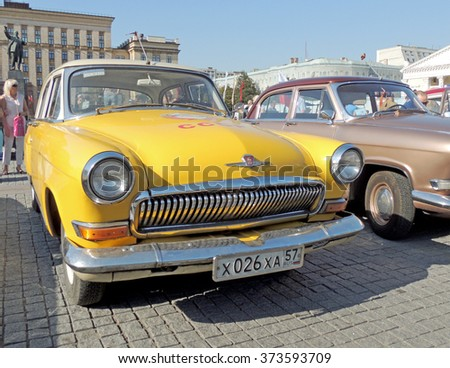 VORONEZH, RUSSIA - September 19, 2015: Urban community around soviet executive car of 1960s sedan GAZ M21 Volga Third Series at the parade of the vintage cars on the city central square - stock photo