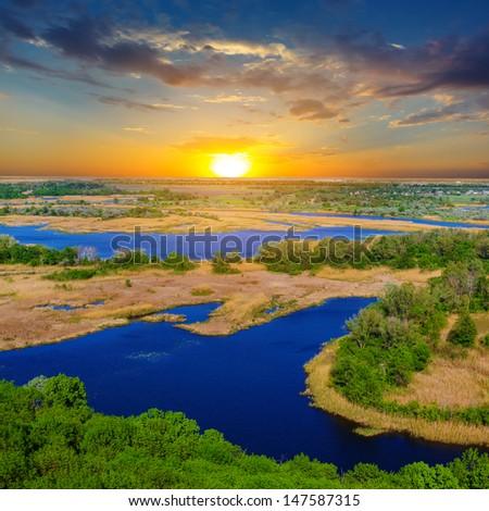 vorskla river at the sunset - stock photo