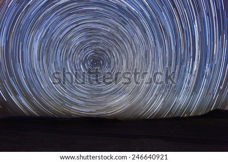 Vortex Night Exposure Star Trails of the Sky - stock photo