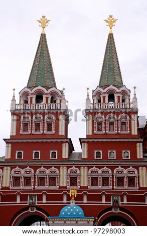 Voskresensky gates is the main entrance to Red Square, Moscow(Russia). The gate is a ornate building situated between Moscow City Hall and the State Historical Museum. - stock photo