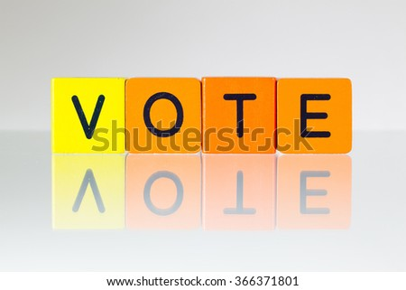 Vote - an inscription from children's wooden blocks - stock photo